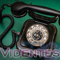 Videntes usando el teléfono fijo o móvil